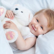 Baby lying in a white bed — Stock Photo #35718205