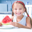 Little girl eating watermelon — Stock Photo