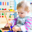 Little girl in the classroom early development — Stock Photo
