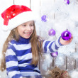 Girl and christmas tree — Stockfoto