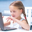 Little girl with her computer — Stock Photo #36417433