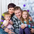 Christmas photo of a happy family — Stok fotoğraf