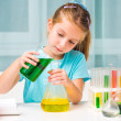 Little girl with flasks — Stockfoto