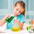 Little girl with flasks — Stock Photo #36417471