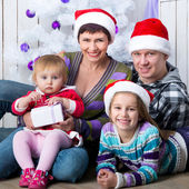 Christmas photo of a happy family — Stock Photo
