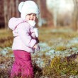 Little girl enjoys the arrival of winter — Stock Photo
