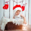 Beautiful little girl near a Christmas — Stock Photo