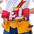 Worker with tools belt — Stock Photo