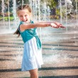 Little girl in splashes fountain — Stock Photo #37710765