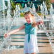 Little girl in splashes fountain — Stock Photo #37710775