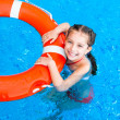 Little girl in the pool — Stock Photo #38472165