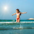 Happy little girl in the sea — Stock Photo #38472227