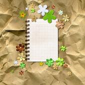 Flowers on kraft paper — Stock Photo