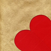 Red heart on the kraft paper — Stock Photo