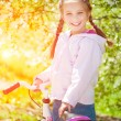 Little girl on her bike — Stock Photo