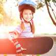 Stock Photo: Cute little girl in a helmet