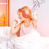 Little girl listening to music — Stock Photo