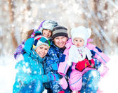 Winter portrait of happy young family — Stock Photo