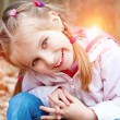 Cute little girl on the wood — Stock Photo #40104187