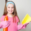 Little girl cleans the house — Stock Photo #40541673