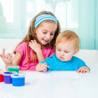 Two sisters draw finger paints — Stock Photo #40541801