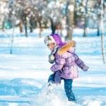 Little girl in winter forest — Stock Photo