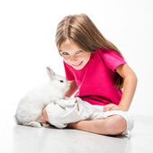 Little girl with her rabbit — Stock Photo