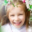 Stock Photo: Little girl with bush blossoming