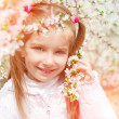 Little girl with bush blossoming — Stock Photo #40748365