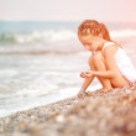 Little girl on the beach — Stock Photo #41776065