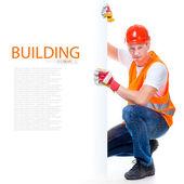 Happy working man in a helmet — Stock Photo