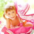 Child with toy carriage — Stockfoto