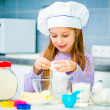 Cute little girl preparing cookies — Stock Photo #41976159