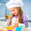Little girl preparing cookies — Stock Photo