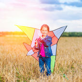 Little girl flies a kite — Stock Photo