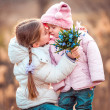 Little girl kissing her sister — Stock Photo