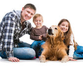 Dad and two daughters  with a dog — Stock Photo