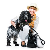 Young modern woman with her dog cocker spaniel — Stock fotografie