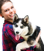 Women with her puppy Husky — Stockfoto