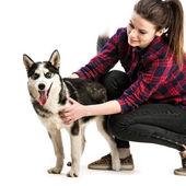 Women with her puppy Husky — Stockfoto