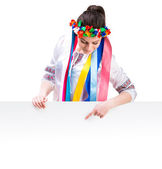 Girl in  Ukrainian  costume behind white board — Stok fotoğraf