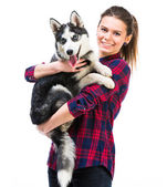 Women with her puppy Husky — Stock Photo