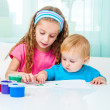 Two sisters draw finger paints — Stock Photo #43686717