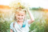 Little cute girl on the field — Stock Photo
