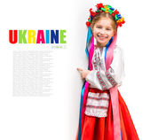 Girl in  Ukrainian  costume behind white board — Stock Photo
