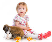 Little girl  with two rabbits — Stock Photo
