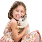 Happy little girl and rabbit — Stock Photo