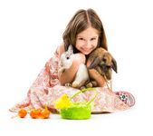 Little girl with her  two rabbits — Stock Photo