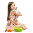 Happy little girl and rabbit — Stock Photo #44482983