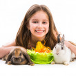 Little girl with her  two rabbits — Stock Photo #44483033